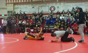 Joshua Wang a split second away from his first pin (and win) in his first wrestling match ever.